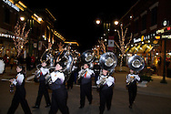 The Beavercreek High School marching band leads the Santa parade and tree lighting celebration at The Greene towne square in Beavercreek, Saturday, November 19, 2011.