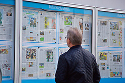 DORTMUND, GERMANY - Thursday, April 7, 2016: A man reads the sports pages of a newspaper in a display cabinet in Dortmund city centre ahead of the UEFA Europa League Quarter-Final 1st Leg match. (Pic by David Rawcliffe/Propaganda)