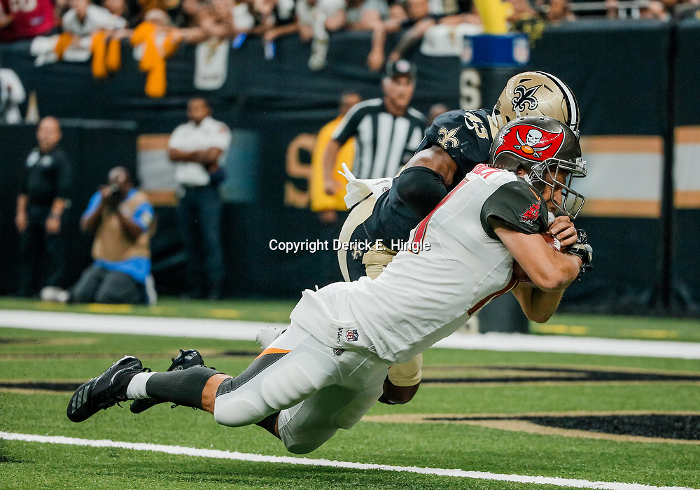 Sep 9, 2018; New Orleans, LA, USA; Tampa Bay Buccaneers quarterback Ryan Fitzpatrick (14) scores past New Orleans Saints safety Marcus Williams (43) during the first quarter of a game at the Mercedes-Benz Superdome. Mandatory Credit: Derick E. Hingle-USA TODAY Sports