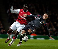Photo: Ed Godden.<br /> Arsenal v CSKA Moscow. UEFA Champions League, Group G. 01/11/2006. Arsenal's Kolo Toure (L) tussles with CSKA Moscow's Daniel Carvalho.