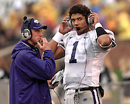 Kansas State quarterback Josh Freeman (1) talks to the coaches in the press box in the first half against Missouri at Faurot Field in Columbia, Missouri, October 21, 2006.  The Tigers beat the Wildcats 41-21.<br />