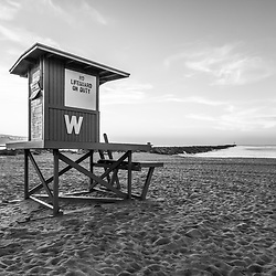 Newport Beach Wedge Lifeguard Station W and Newport Jetty black and white photo. The wedge lifeguard stand and jetty are a popular surfing spot in Orange County Southern California in the United States of America. Photo Copyright ⓒ 2010 Paul Velgos with All Rights Reserved.