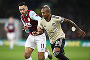 Manchester United midfielder Ashley Young (18) and Burnley midfielder Dwight McNeil (11) during the Premier League match between Burnley and Manchester United at Turf Moor, Burnley, England on 28 December 2019.