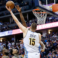 22 March 2017: Denver Nuggets forward Nikola Jokic (15) goes for the baby hook over Cleveland Cavaliers center Tristan Thompson (13) during the Denver Nuggets 126-113 victory over the Cleveland Cavaliers, at the Pepsi Center, Denver, Colorado, USA.