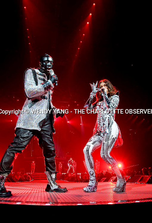 "will.i.am and Fergie of the Black Eyed Peas performed Saturday night at Time Warner Cable Arena in Charlotte, NC. ""The E.N.D. World Tour 2010"" featured LMFAO. WENDY YANG - wyang@charlotteobserver.com"