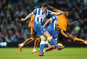 Brighton striker (on loan from Manchester United), James Wilson (21) shoots during the Sky Bet Championship match between Brighton and Hove Albion and Wolverhampton Wanderers at the American Express Community Stadium, Brighton and Hove, England on 1 January 2016.