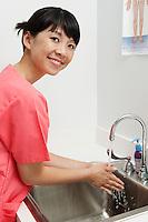 Female nurse washing hands in hospital,portrait