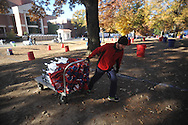 Austin Dixon prepares to set up tents for tailgating, in the Grove at Ole Miss, in Oxford, Miss. on Friday, November 28, 2014. Ole Miss hosts Mississippi State in the annual Egg Bowl on Saturday at 2:30 p.m.