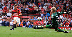 Michael Owen goes close to scoring as he chips over Birmingham City's Joe Hart during the Barclays Premier League match between Manchester United and Birmingham City at Old Trafford on August 16, 2009 in Manchester, England.