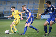 Will Hatfield (Guiseley) shields the ball from Kingsley James (Halifax) during the Conference Premier League match between FC Halifax Town and Guiseley at the Shay, Halifax, United Kingdom on 5 December 2015. Photo by Mark P Doherty.