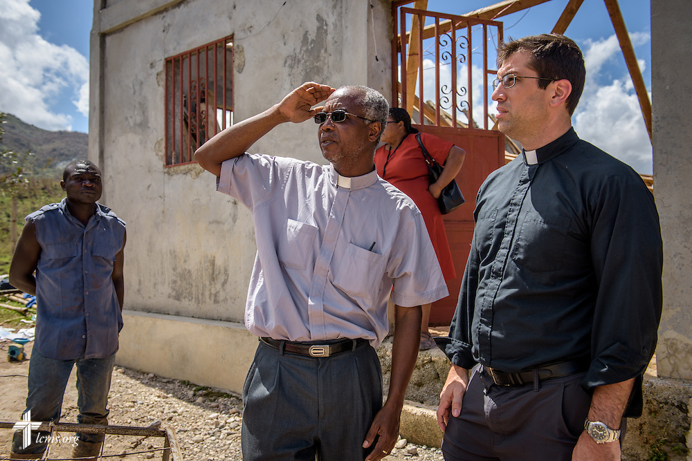 The Rev. Paul Toulette, pastor in The Evangelical Lutheran Church in Haiti, and the Rev. Ross Johnson, director of LCMS Disaster Response, stand together in a Lutheran parish destroyed by Hurricane Matthew on Wednesday, Oct. 12, 2016, in Duchity, Haiti. LCMS Communications/Erik M. Lunsford