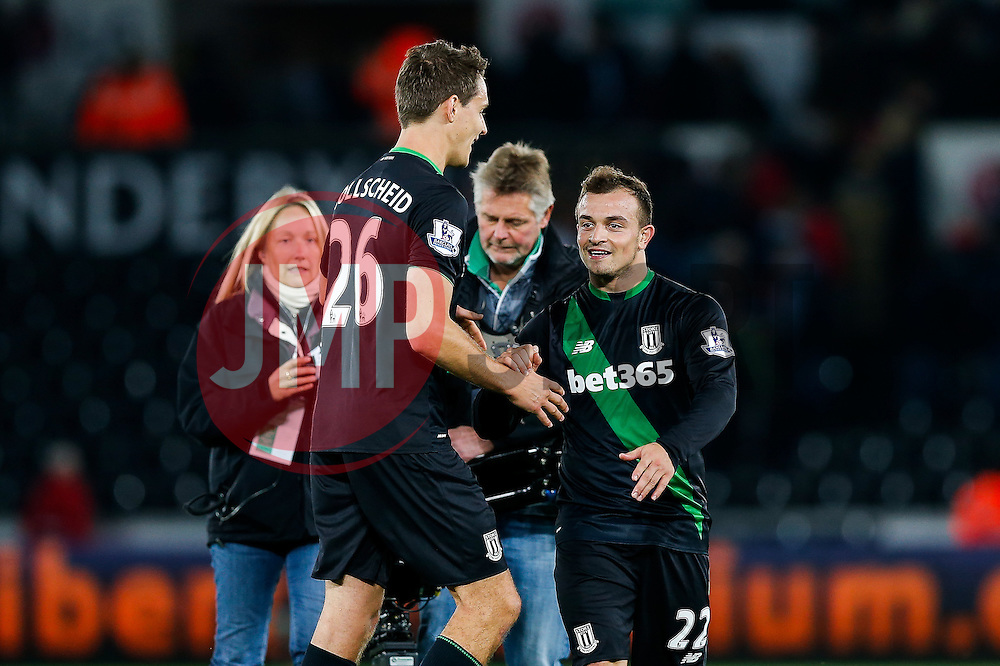 Philipp Wollscheid and Xherdan Shaqiri celebrate after Stoke City win the match 0-1 - Mandatory byline: Rogan Thomson/JMP - 07966 386802 - 19/10/2015 - FOOTBALL - Liberty Stadium - Swansea, Wales - Swansea City v Stoke City - Barclays Premier League.