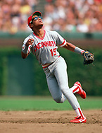 CHICAGO - 1990: Barry Larkin of the Cincinnati Reds fields during an MLB game against the Chicago Cubs at Wrigley Field in Chicago, Illinois during the 1990 season. (Photo by Ron Vesely).  Subject:   Barry Larkin