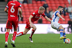 Craig Conway of Blackburn Rovers is challenged by Taylor Moore of Bristol City - Rogan Thomson/JMP - 22/10/2016 - FOOTBALL - Ashton Gate Stadium - Bristol, England - Bristol City v Blackburn Rovers - Sky Bet EFL Championship.