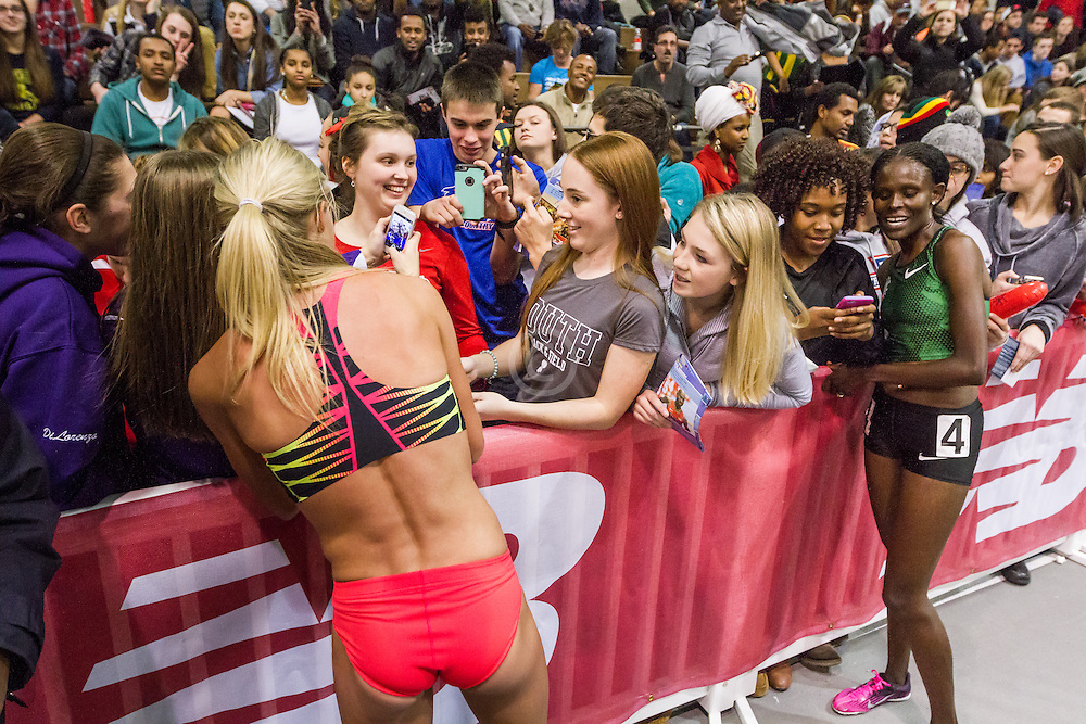 New Balance Indoor Grand Prix Track & FIeld:   Women's 2000 meters, Emma Coburn signs autographs for fans trackside