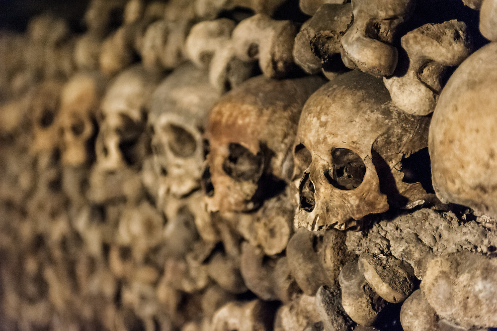 Stock photograph of skulls in the Catacombs of Paris