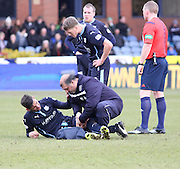 Dundee FC physio Niam Mohammed gives treatment to Luka Tankulic- Dundee v Celtic, William Hill Scottish Cup fifth round at Dens Park <br /> <br /> <br />  - &copy; David Young - www.davidyoungphoto.co.uk - email: davidyoungphoto@gmail.com