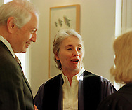 Peter Solmssen, left, President of The University of the Arts, Camille Paglia, center, and Provost Virginia Red, share a laugh before the start of commencement ceremonies at the University of the Arts, Thursday, May 20, 1999, in Philadelphia.  (Photo by William Thomas Cain)