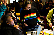 Ali Muldrow shares a laugh with supporters  after looking at preliminary results during the Madison School Board election watch party at Robinia Courtyard in Madison, Wisconsin, Tuesday, Feb. 19, 2019.