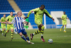 COLCHESTER, ENGLAND - Saturday, April 24, 2010: Tranmere Rovers' Bas Savage out muscles Colchester United's Marc Tierney for the ball during the Football League One match at the Western Community Stadium. (Photo by Gareth Davies/Propaganda)