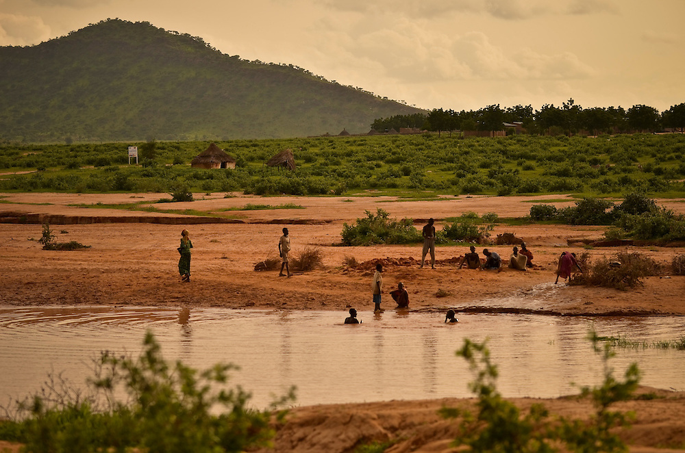 Children swim outside of Djabal refugee camp, near Goz Beida, in eastern Chad.