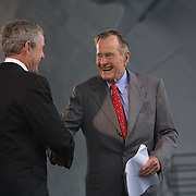 Pres. Bush, alongside former President George H W Bush and former First Lady Barbara Bush, christen CVN-77 George H W Bush aircraft carrier Saturday, October 7, 2006, in Newport News, Virginia (VA).  CVN-77 is the 10th and final of the Nimitz-class aircraft carriers.  It is set to replace the USS Kitty Hawk in 2008...Photo by Khue Bui