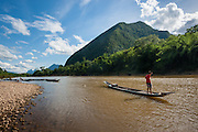 Boy on a boat on Nan Ou river at Muang Ngoi (Laos)