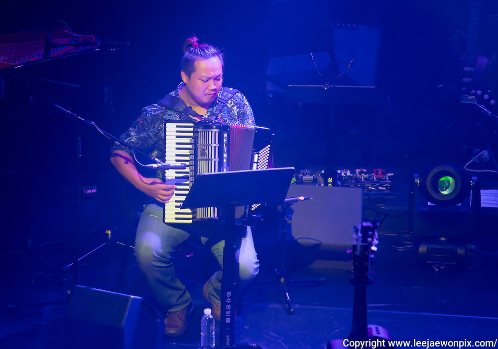 A jazz pianist and accordionist Slki Lim plays accordian during a showcase for South Korean singer-songwriter Baekja's third album at Seongsu art-hall in Seoul, South Korea, September 8, 2016. Photo by Lee Jae-Won (SOUTH KOREA)  www.leejaewonpix.com