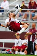 August 27, 2009: Joe Karikas of Genoa does a bicycle kick in the High School Soccer game Lake at Genoa. Genoa won 1-0.