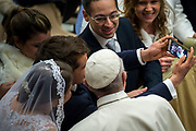 Pope Francis Blesses the newlyweds at the end of his weekly general audience at the Paul VI audience hall on December 13, 2017 at the Vatican.