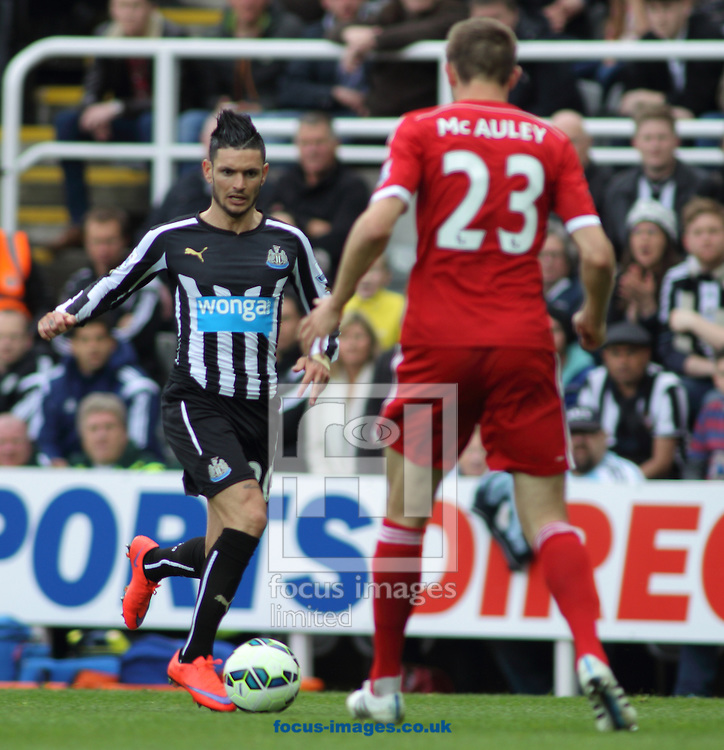 Remy Cabella  (L) of Newcastle United on the attack against Gareth McAuley (R) of West Bromwich Albion during the Barclays Premier League match at St. James's Park, Newcastle<br /> Picture by Stephen Gaunt/Focus Images Ltd +447904 833202<br /> 09/05/2015