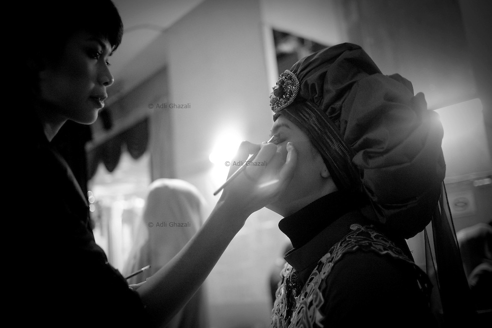 Model having makeup done before the Islamic Fashion Festival held at JW Marriot Hotel on November 10, 2010 Kuala Lumpur, Malaysia.