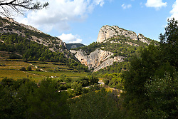 Terraces of vineyards work their way up the sides of the Dentelle mountains in the Vaucluse department of Provence.