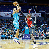 01 November 2015: Charlotte Hornets forward Nicolas Batum (5) takes a jump shot over Atlanta Hawks forward Paul Millsap (4) during the Atlanta Hawks 94-92 victory over the Charlotte Hornets, at the Time Warner Cable Arena, in Charlotte, North Carolina, USA.