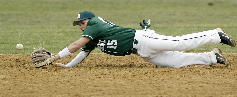 Minisink Valley second baseman Carlos Mapes dives but cannot reach a ground ball during a game against Monroe-Woodbury in Slate Hill on Friday, April 8, 2011.