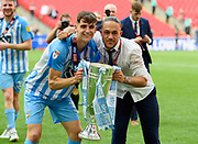 Coventry City's Chris Stokes (3)  and Coventry City's Jodi Jones (11) celebrate with the winners trophy after winning the League 2 Play-Off final during the EFL Sky Bet League 2 play-off final match between Coventry City and Exeter City at Wembley Stadium, London, England on 28 May 2018. Picture by Jon Hobley.