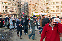 An injured man walks toward a safer part of Tahrir Square after being hit in the head by a rock or other hard object during a clash with Mubarak supporters (Cairo, Egypt - February 2, 2011)