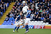 Fulham striker Moussa Dembele flicks on a header during the Sky Bet Championship match between Birmingham City and Fulham at St Andrews, Birmingham, England on 19 March 2016. Photo by Alan Franklin.