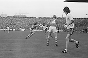 Tyrone goes for a kick while Kerry attempts to block the ball during the All Ireland Minor Gaelic Football Final, Tyrone v Kerry in Croke Park on the 28th September 1975.