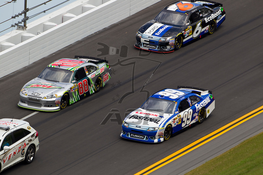 Daytona Beach, FL - Feb 23, 2012: Carl Edwards (99), brings his Ford Fusion through the turns during the Gatorade Duel 1 race at the Daytona International Speedway in Daytona Beach, FL.