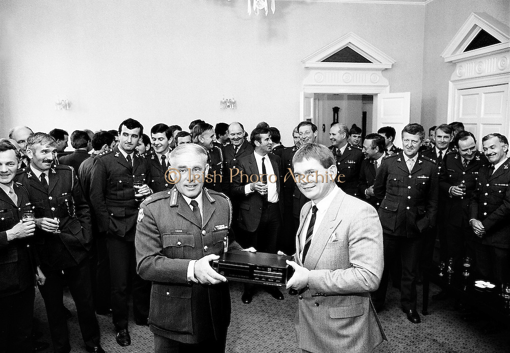 To mark his retirement from the Defence Forces, Irish international rugby legend Ciaran Fitzgerald is presented with a hi-fi system by Brigadier General Vincent Savino on behalf of his friends and colleagues.<br />