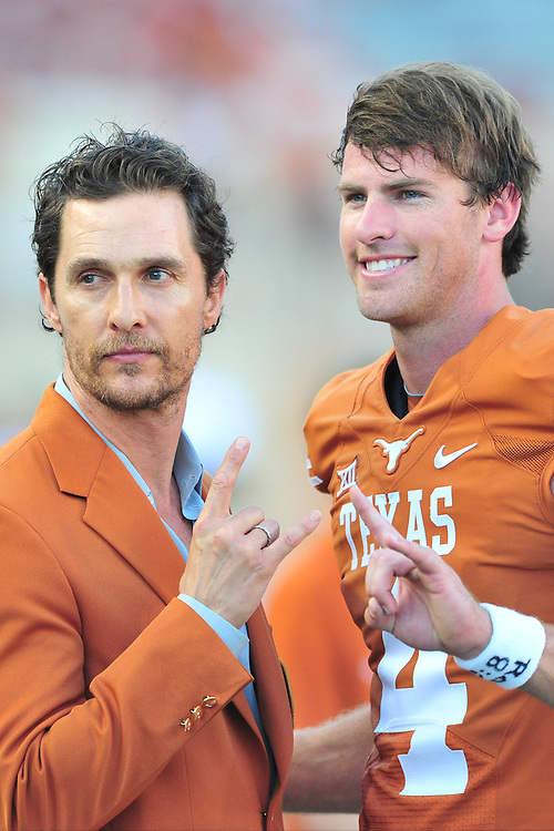 AUSTIN, TX - OCTOBER 18:  Matthew McConaughey poses for a photo with William Russ #4 of the Texas Longhorns before kickoff against the Iowa State Cyclones on October 18, 2014 at Darrell K Royal-Texas Memorial Stadium in Austin, Texas.  (Photo by Cooper Neill/Getty Images) *** Local Caption *** William Russ; Matthew McConaughey