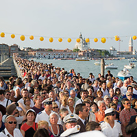VENICE, ITALY - JULY 16:  Pilgrims walk on the votive pontoon bridge across Giudecca Canal for the Redentore Celebrations on July 16, 2011 in Venice, Italy. Redentore is the celebration most loved by Venetians, to remind the end of the plague in 1577 higlights of the celebration are the poonton bridge across the Giudecca Canal, people gatherings on boats in the St Mark's basin and spectacular fireworks display.