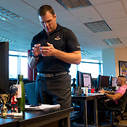 JUNE 15, 2017--SUNRISE, FLORIDA<br /> Shawn Thornton, a former Boston Bruins player known as the team's enforcer, is now the Florida Panthers VP for business operations. Here he checks his smart phone in his office space.<br /> (Photo by Angel Valentin/Freelance)