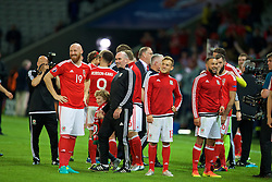 LILLE, FRANCE - Friday, July 1, 2016: Wales' James Collins, performance psychologist Ian Mitchall and George Williams celebrate after a 3-1 victory over Belgium and reaching the Semi-Final during the UEFA Euro 2016 Championship Quarter-Final match at the Stade Pierre Mauroy. (Pic by David Rawcliffe/Propaganda)