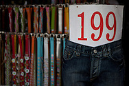 Jeans and belts for sale at Chatuchak JJ market in Bangkok, Thailand