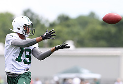 June 14, 2012; Florham Park, NJ, USA; New York Jets wide receiver Eron Riley (19) catches a pass during New York Jets Minicamp at the Atlantic Health Training Center.
