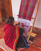 Lady weaving traditional cloth in Sucre, Bolivia