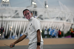 © Licensed to London News Pictures.27/07/2012 LONDON UK. Cast member dressed as a doctor wearing a Danny Boyle mask makes his way to the stadium, during the opening Ceremony of the London 2012 Olympic Games. Photo credit : Andrew Baker/LNP