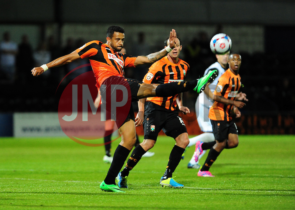 Barnet v Bristol Rovers - 10.08.14,<br /> Barnet's David Stephens clears a Rovers attack